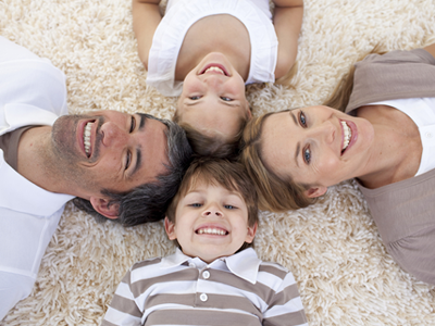 Family of Four on Carpet